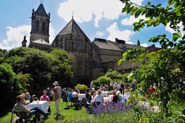 Visitors enjoy the strawberry tea event in the rectory gardens behind St Wilfrid's Church in York