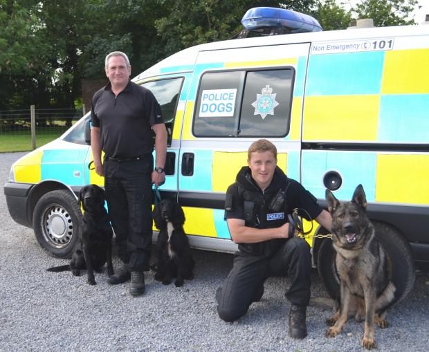 York Press: PC Vince Gillon, left,  with trainee police dogs Jacob and Atom and PC Martin Gayles with Thor