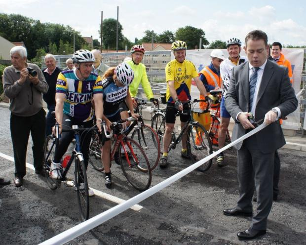 Members of a cycling group attend the official reopening of the Lumby Dock  bridge by Nigel Adams, MP for Selby and Ainsty