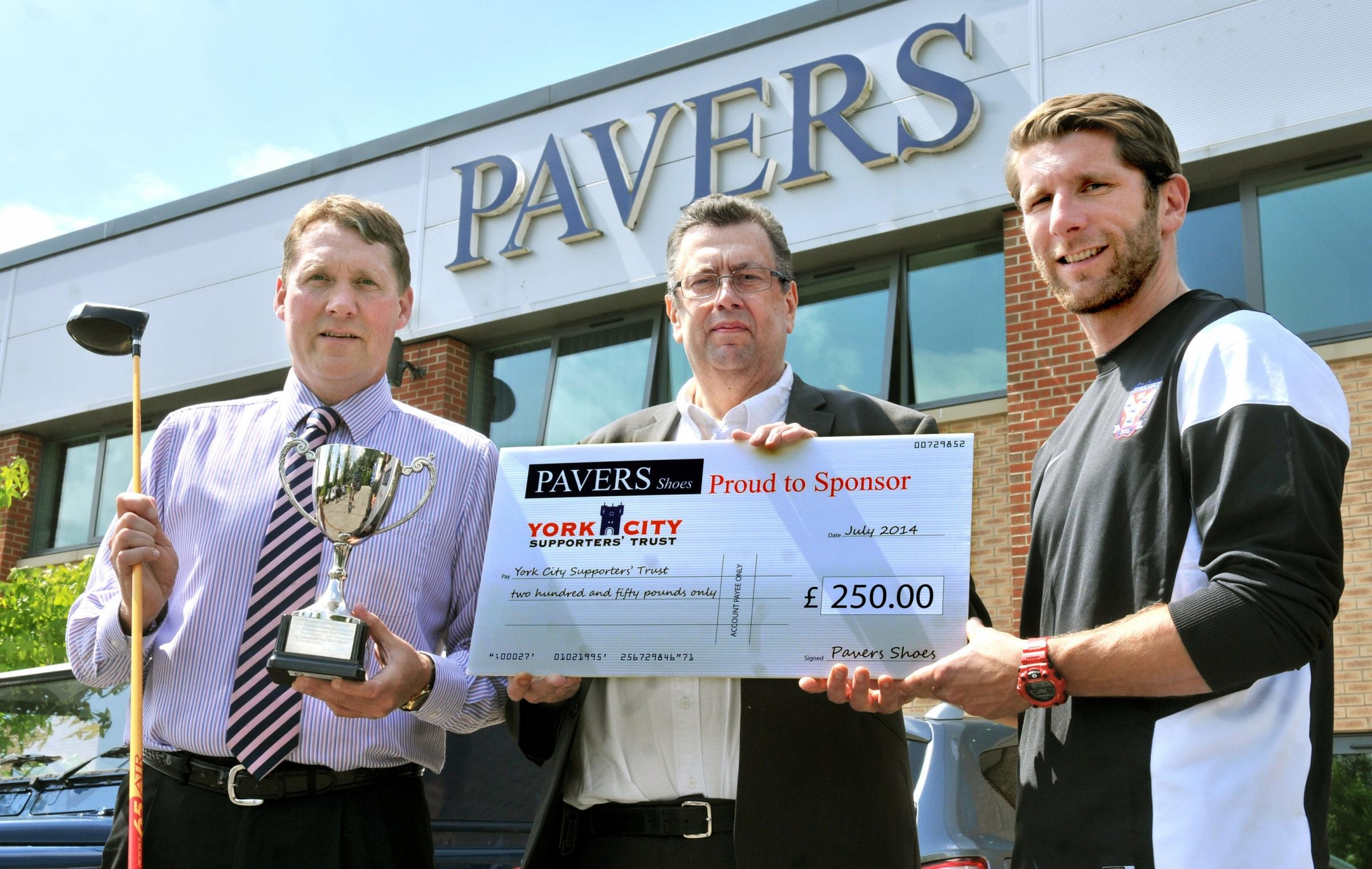 : York City's Richard Cresswell receives a cheque from Mark Granger, of Pavers, left, and Steve Beck, of York City Supporters Trust, centre, at Pavers' headquarters