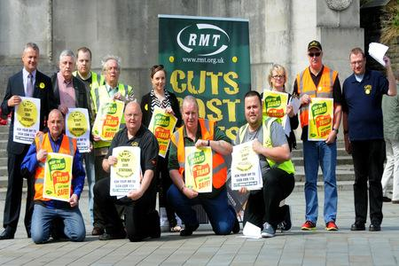 CUTS ANGER: Members of the RMT Union protest against proposed cuts to rail staff ahead of a meeting at West Offices