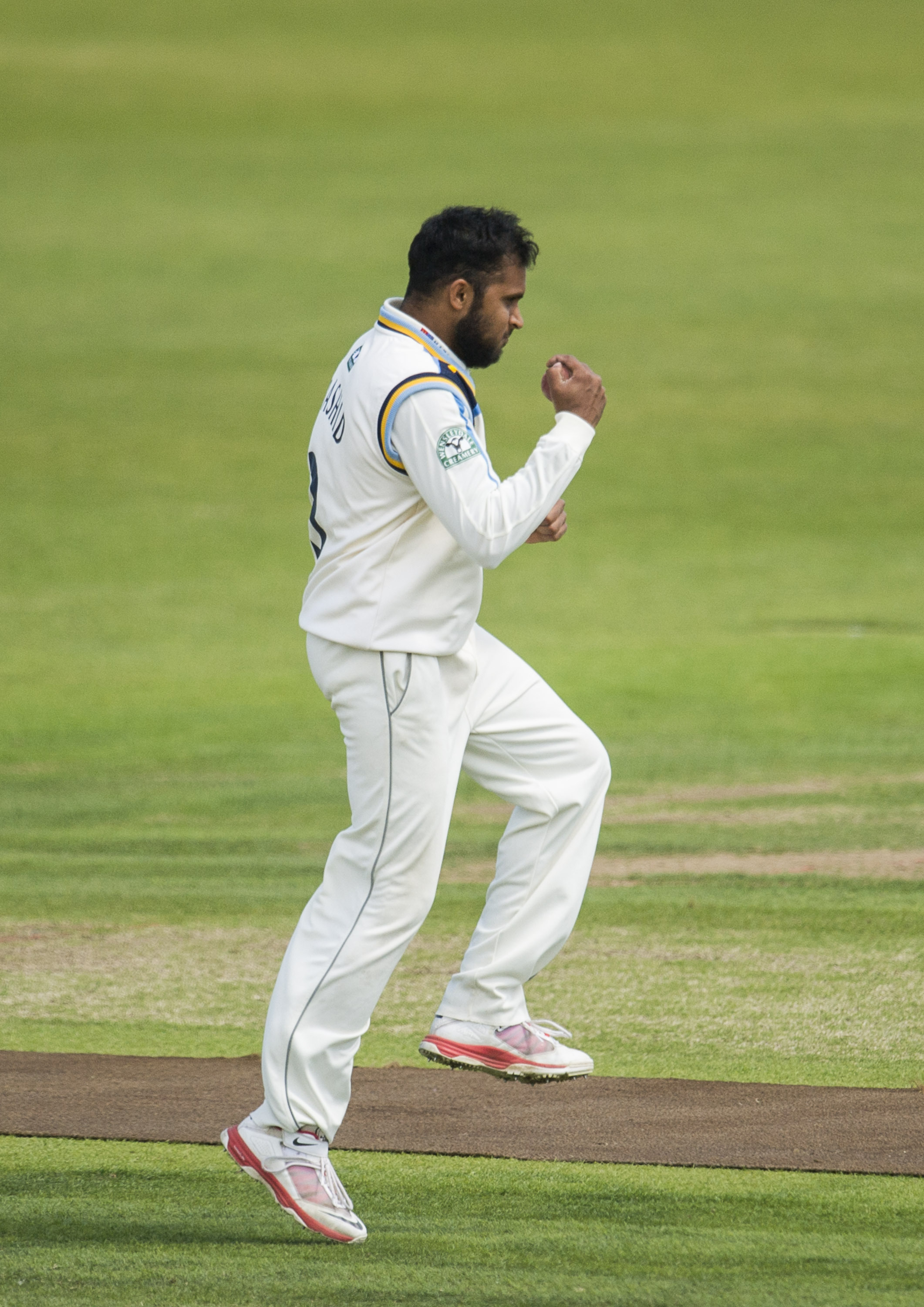 New dad Adil Rashid reacts after catching Durham's Michael Richardson off his own bowling. Picture by Allan McKenzie/SWpix.com