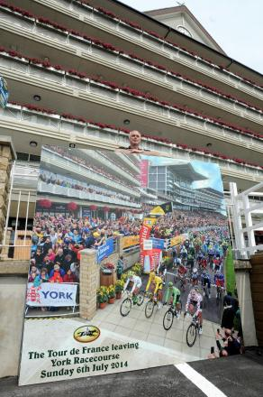 Operations director Tony Lee with the giant photograph showing the start of the Tour de France at York Racecourse.