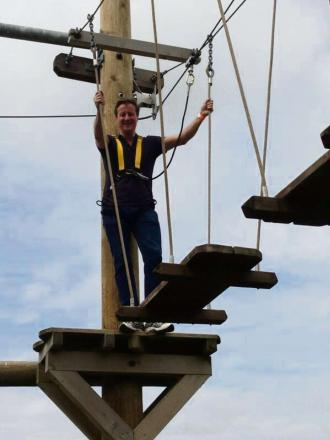 Prime Minister David Cameron takes a break on the high wires at Creepy Crawlies
