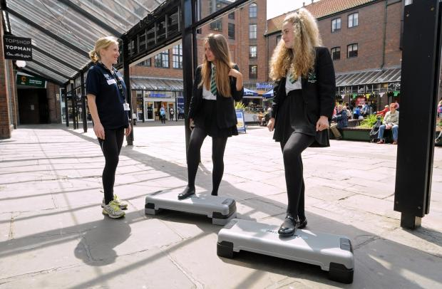 Lorna Galdas, City of York Council's young people's physical activity officer, with Joseph Rowntree School pupils Imogen Black (centre) and Ellie Nendick trying step aerobics during the Body Confidence day in Coppergate