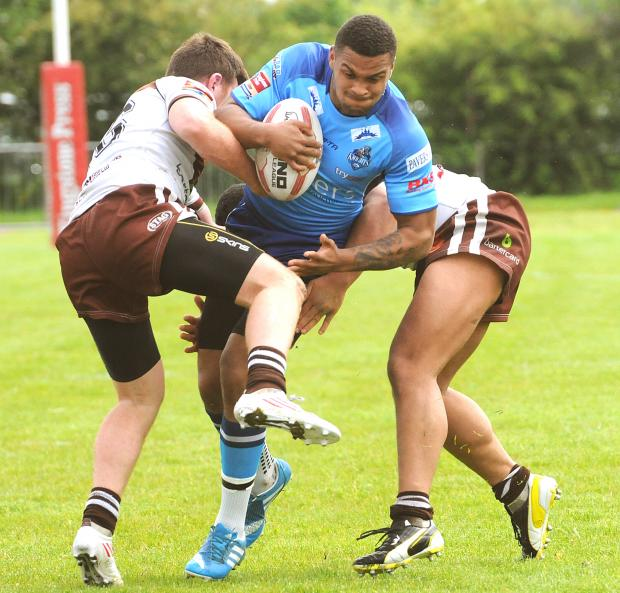 York City Knights' Colton Roche in barnstorming action against Hunslet