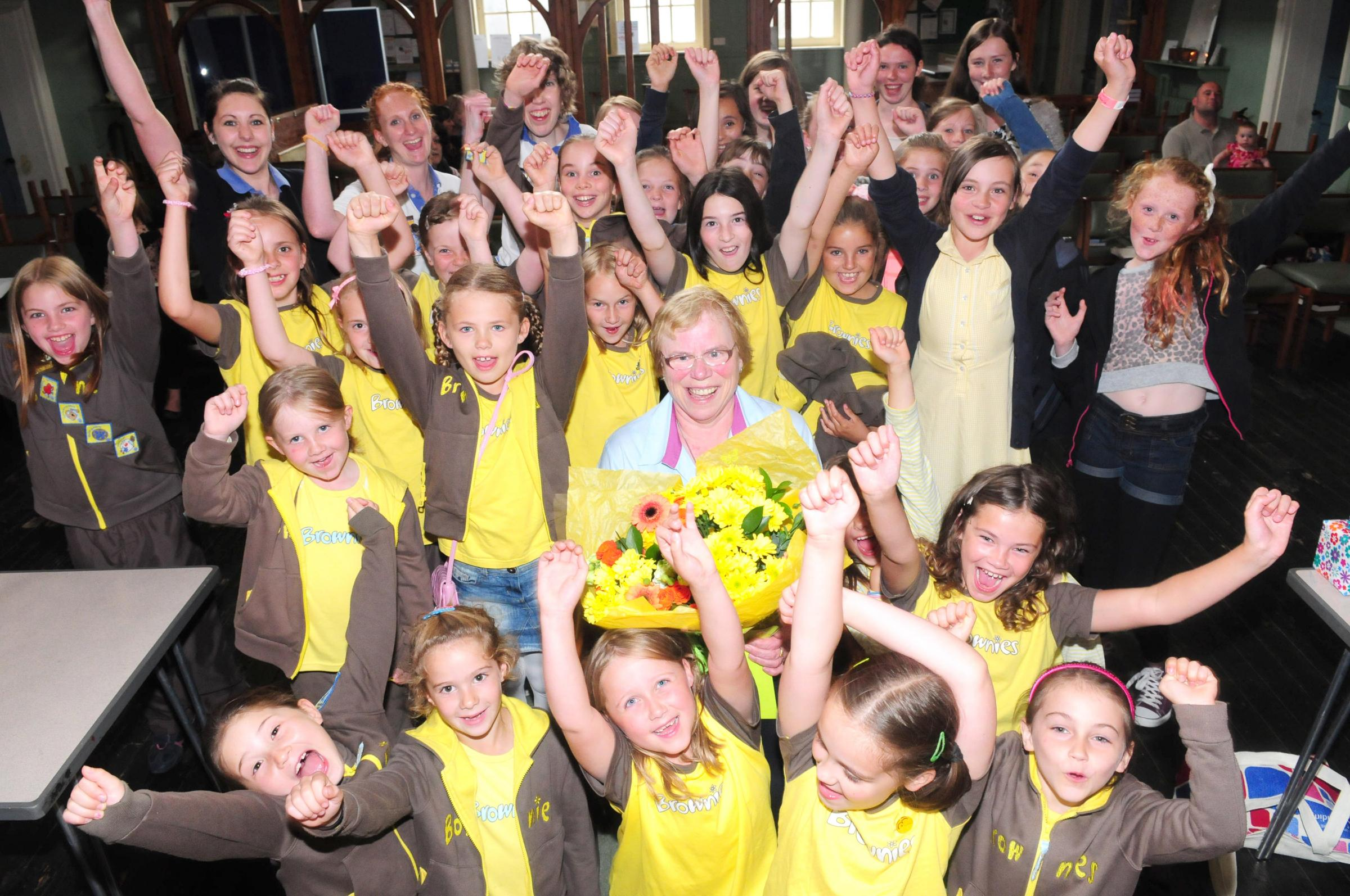 : Janet Strodder is surrounded by members of the Brownie community at Holgate Methodist Church as she leaves after more than 45 years.