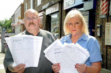 Gordon Campbell-Thomas and Dee Grace, the manager of the Betfred shop in Lowther Street, with the petition to appealing for that area of the Groves to be a no-alcohol area