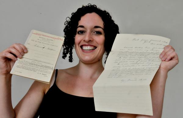 Elanor Dunn with the report and letter she found in a chest of drawers