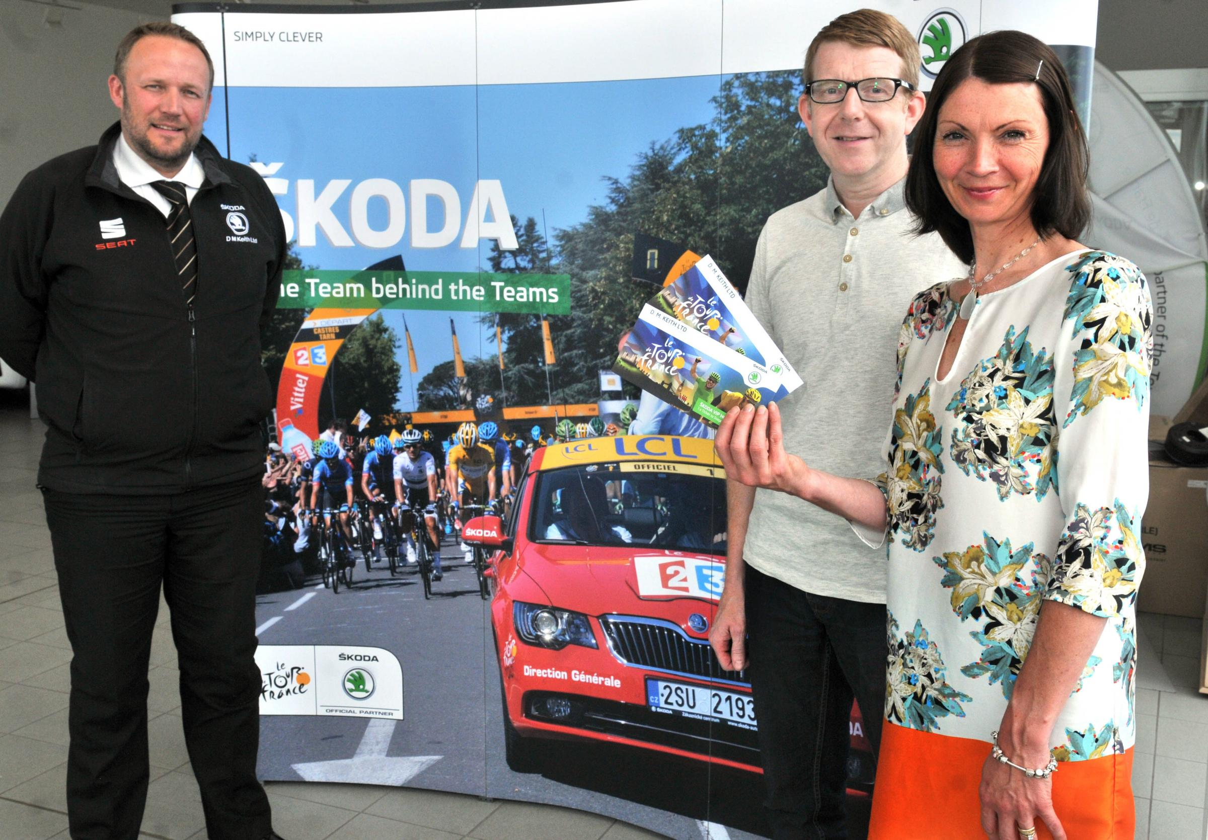 Jeremy Preece, left, with competition winners Simon and Claire Cawood at DM Keith.                                      Picture:  Nigel Holland