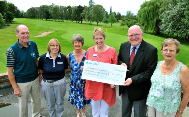Janet Morley, director of Fundraising at St Leonard's Hospice, receives a cheque for £11,000 from Bob Crome watched by, from left, club captain Tony Hinder, Fiona White,  Joan Foster and Kath Stubbs at Fulford Golf Club