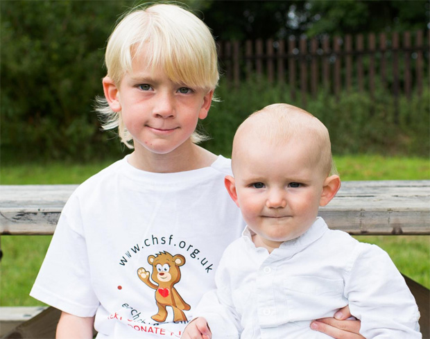 York Press: PROTECTIVE: William Flatt, aged seven, with his brother, Charlie, who has had open-heart surgery and who celebrates his first birthday tomorrow                                                                   Picture: Allan Scott Photography