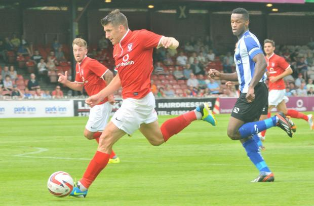Set-piece specialist Michael Coulson in action in the pre-season opener against Sheffield Wednesday