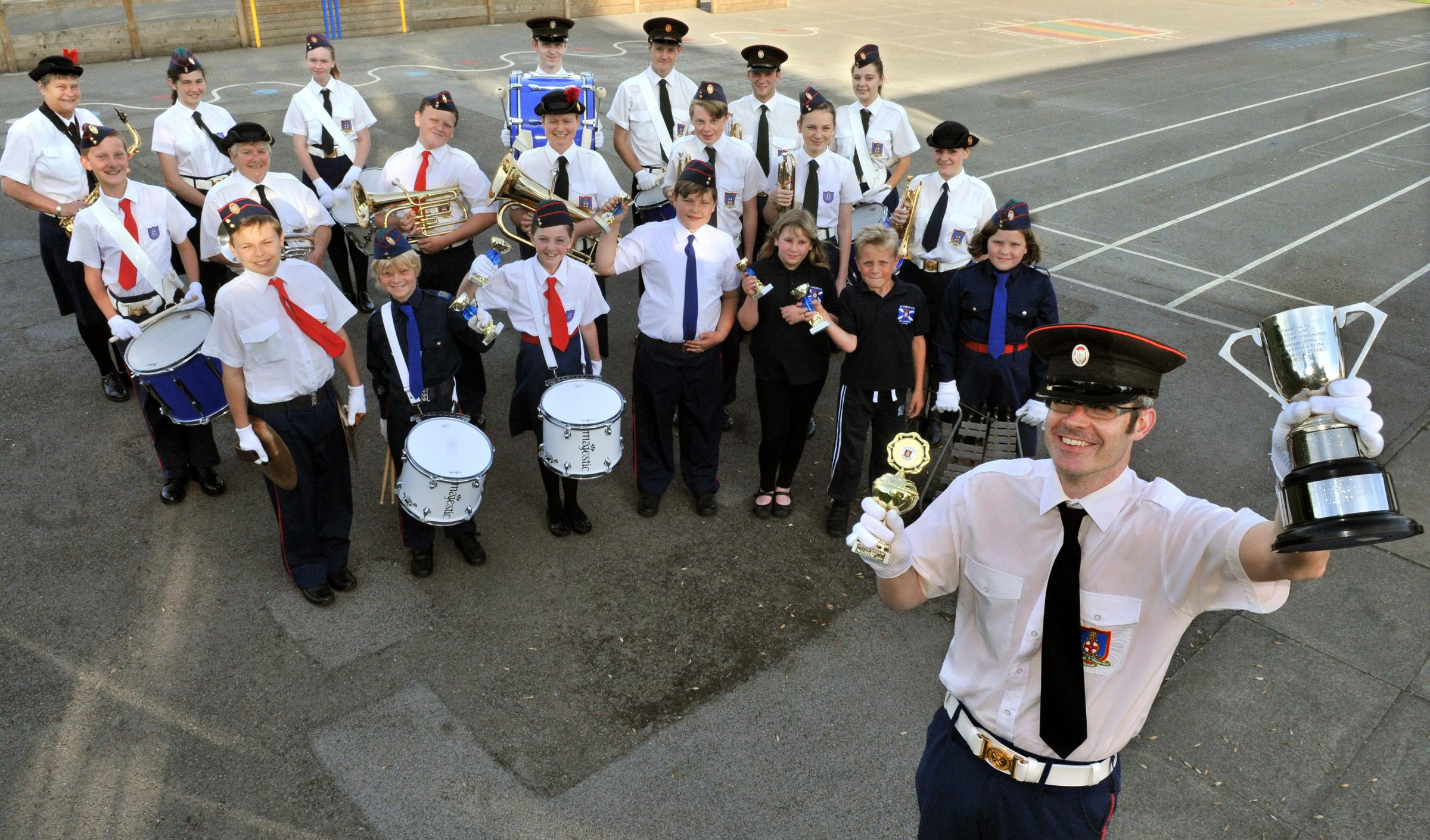 Andy Stubbs with members of St Andrew's Band, who have won a national award for the fifth time