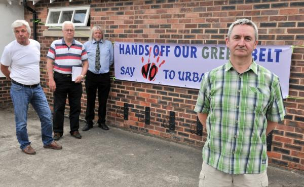 Earswick protesters John Pace, Jim McTurk, Tony Fisher and Pete Sokolow outside the village hall