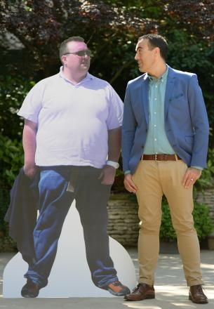 Brendan O'Donnell, 31, from East Yorkshire, who has been named Slimming World Man of the Year after losing 11st 3lbs, stands next to a cardboard cut out of himself taken before the weight loss