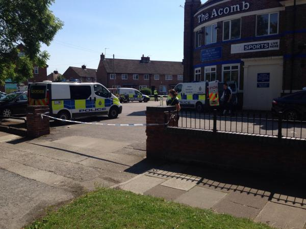 Police at The Acomb yesterday