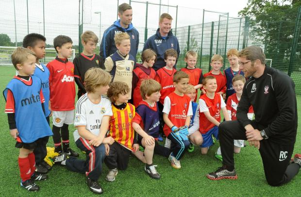 Former York City striker Richard Cresswell, now the club's development consultant, talks to youngsters at a recent York City in the Community's football camp at York Sport Village