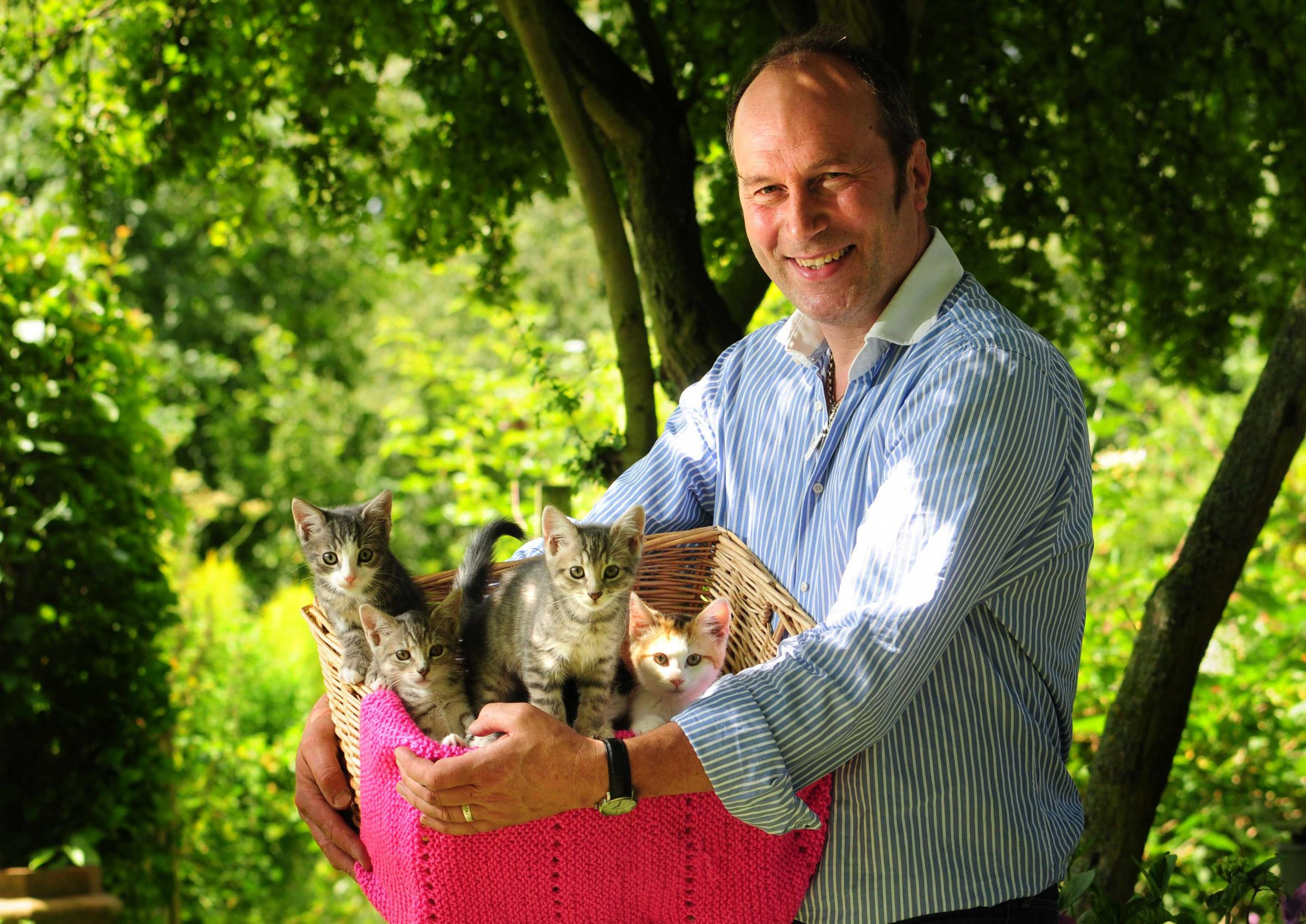 James Watruss with some of the 30 cats the Cats Protection League, in Amotherby, is trying to rehome