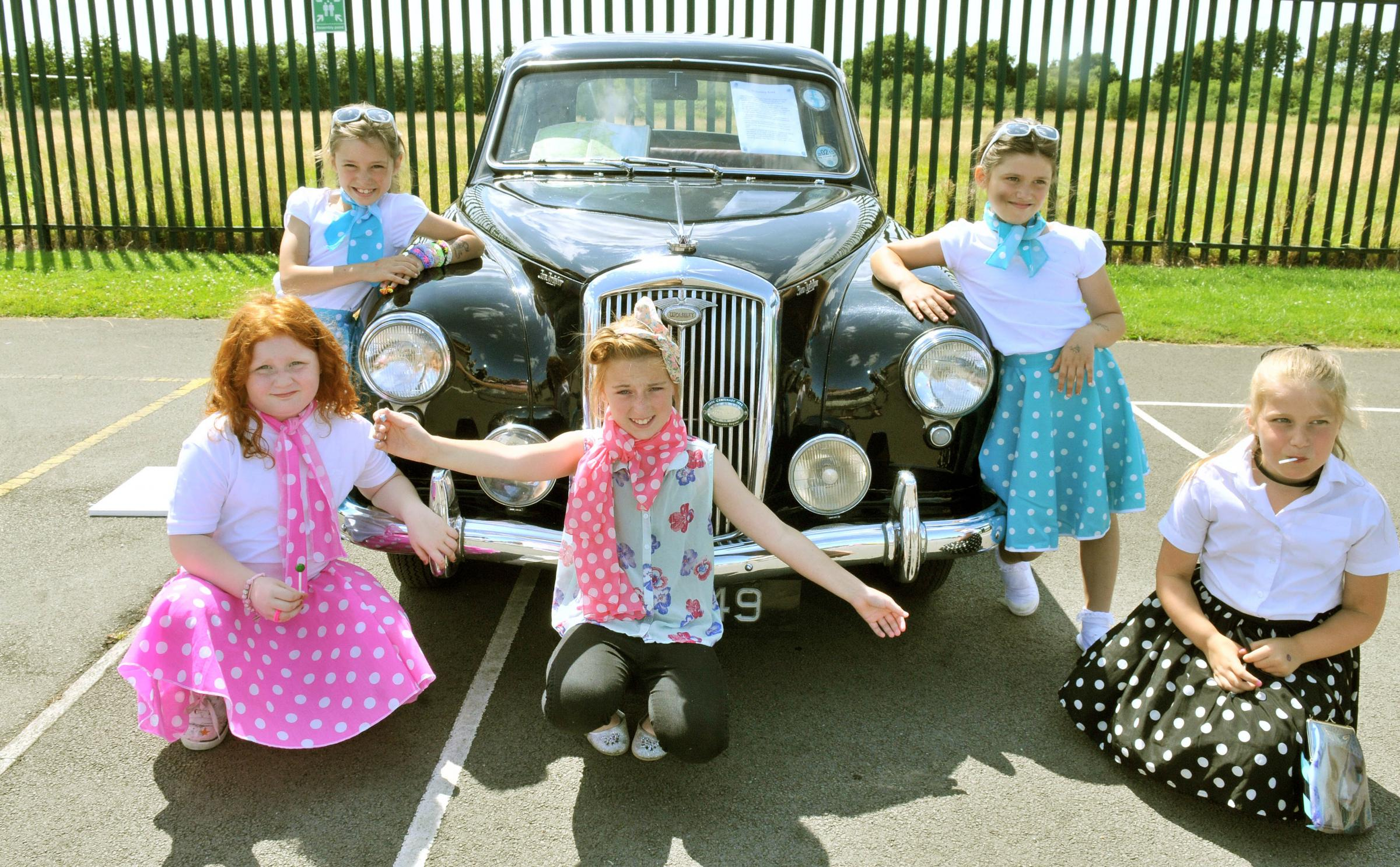 Pupils at Burton Green School celebrate their 60th anniversary