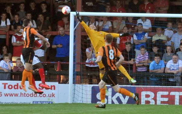 York City goalkeeper Michael Ingham, who returned from injury against Hull City, is pictured at full stretch keeping out a header from Shane Long