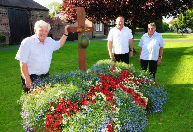 Stuart Robson, Brian Deamer and Mike Walker pictured with the decorative flower bed in Poppleton marking the anniversary of World War One