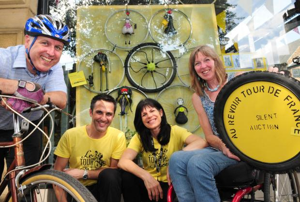 Charity cyclist Mike Hughes, Martin Harman, Adele Proctor and Belinda Noda outside Your Bike Shed where there will also be a charity auction on Sunday