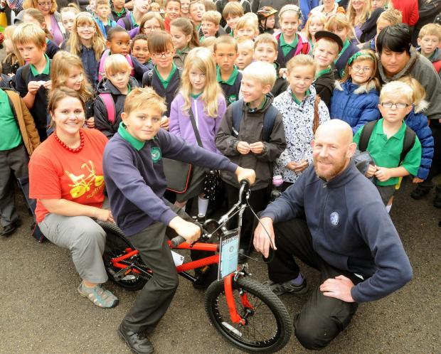 Nine-year-old Luke Dorking is presented with a bicycle by Naomi Wells Smith, of Sustrans, and Piers Maffett, of Cycle Heaven, at a Bike It Project event at Yearsley Grove School Atkinson