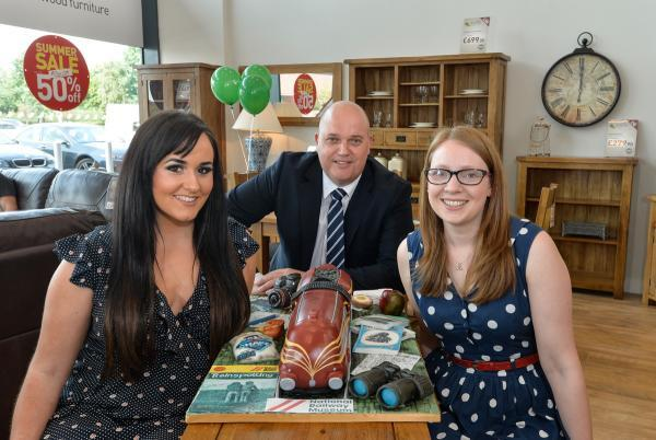 Pictured with the cake are, from left, its creator, Molly Robbins, store manager, Jason Matthews and City of York Councillor, Linsay Cunningham-Cross, who opened the new store, Jason Matthews and City of York C