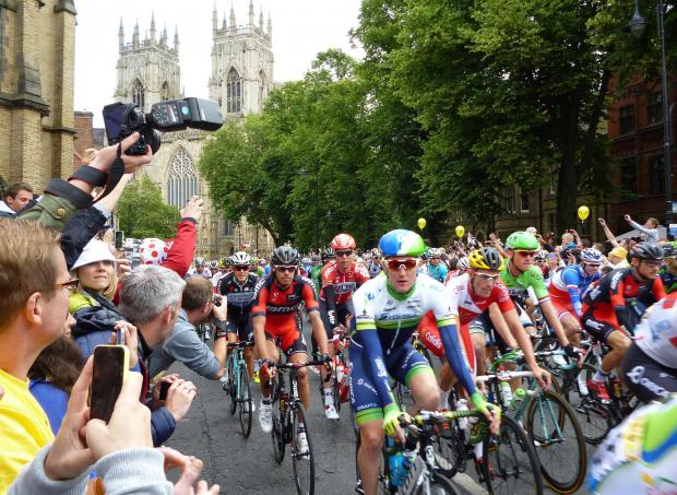 The Tour de France riders pass York Minster