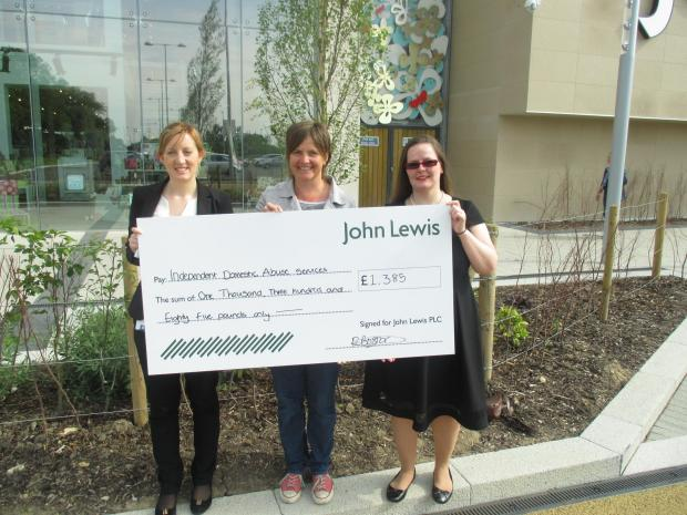 The donation from John Lewis is handed over to the Independent Domestic Abuse Services