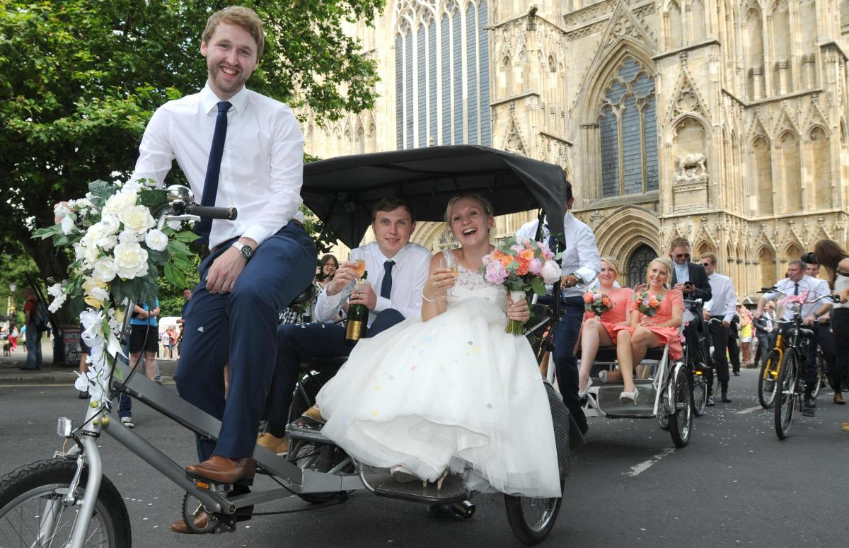 Wedding Party Cycles Through The Streets Of York To Their Reception