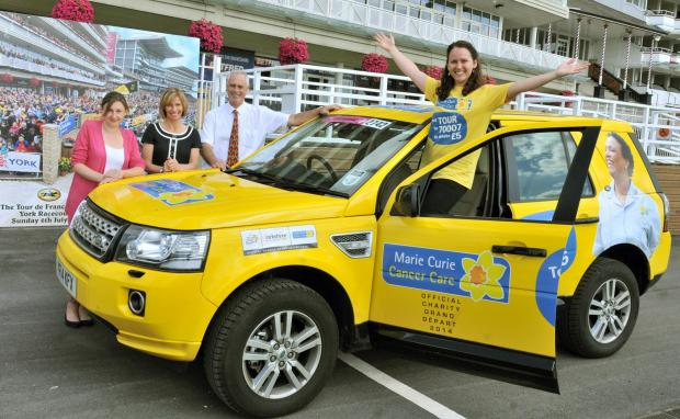 Natalie Atherley, from Marie Curie, with racecourse staff Amy Swales, Louise Daly and Tony Lee. Marie Curie has thanked the people of York for their Le Tour generosity