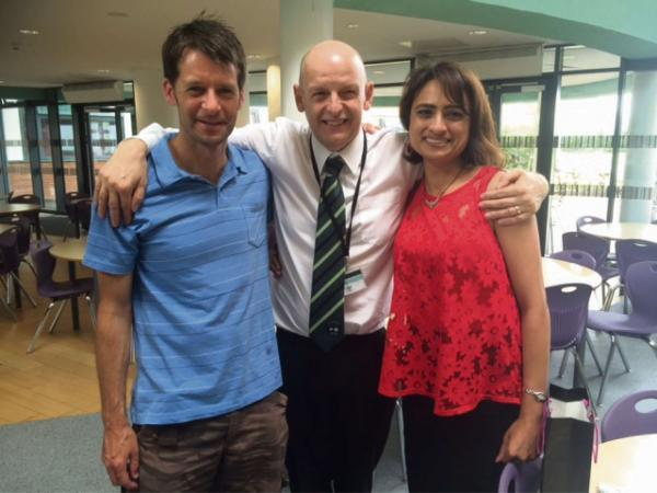 Pastures new: Phil Armstrong, centre, says farewell to department colleagues Richard Ayres and Bhranti Naik
