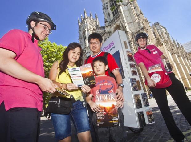 The Razali family from Jakarta, Indonesia get advice on where to visit as the Visit York digibike travels around York