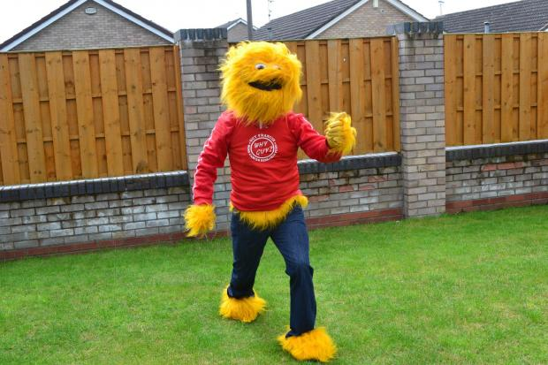 GIANT STRIDES: The Honey Monster prepares to lead the Guy Francis Bone Cancer Research Fund team in the York 10K