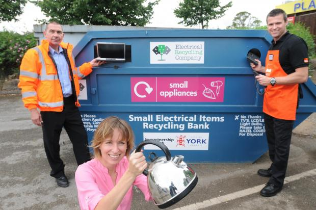 From left, Paul Sellers, of the Electrical Recycling Company, Sara Goodhead,  waste strategy officer, and Nik Rowntree, deputy manager at B&Q at Hull Road, with the new electrical waste bank based there