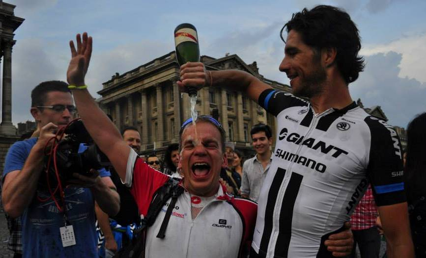 Phil Wiggins, known as Wiggo, parties with Tour de France riders at the end of his 4,000 mile challenge