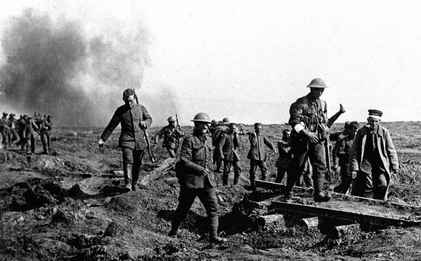 German prisoners helping to carry wounded British soldiers back to their trenches  1916 after an attack near Ginchy during the Battle of the Somme