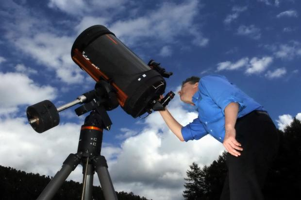 Amateur astronomer Richard Darn gets ready for the Stonehaugh stargazing event