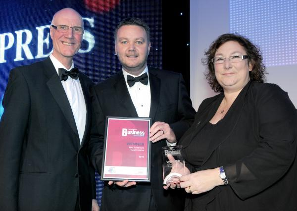 David Short, left, presents the Best Sustainable Travel Initiative award to Julie Jones and David O'Neill of TSYS, at last year's final ceremony