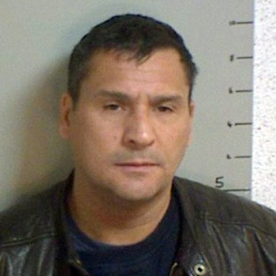 Bungling raider jailed for 13 years