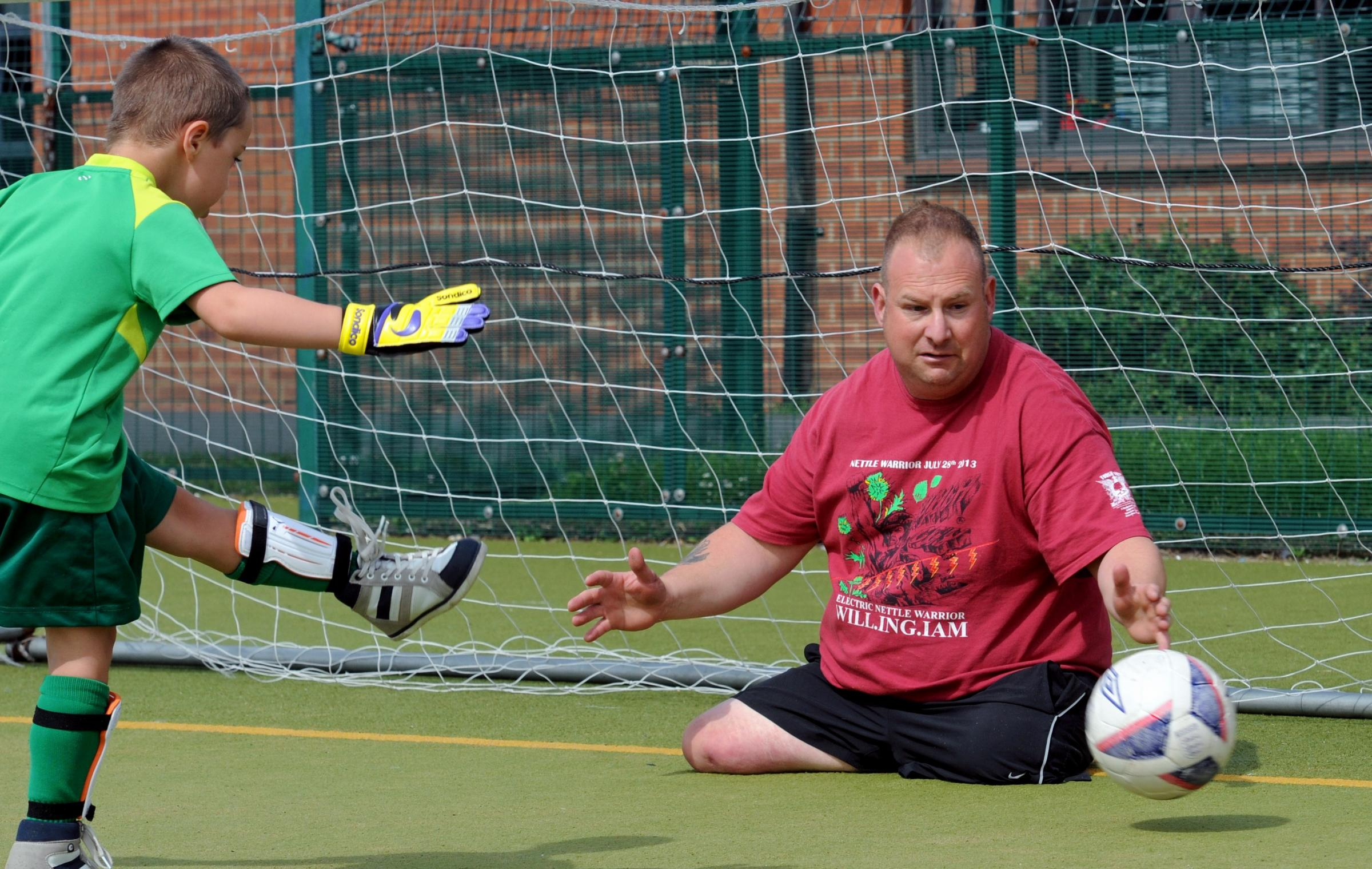 Para triathlete Alan Rayment in goal for a game of football during the disability sports day at Energise