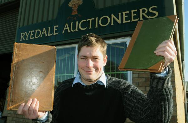 Angus Ashworth at Ryedale Auctioneers, in Kirkbymoorside, with the two 17th century books