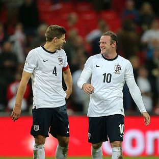 Wayne Rooney, right, is favourite to succeed Steven Gerrard as England captain