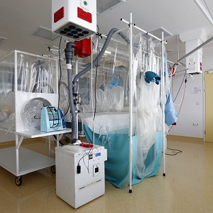 A high level isolation apparatus suitable for treating Ebola victims in a secure unit at The Royal Free Hospital, London