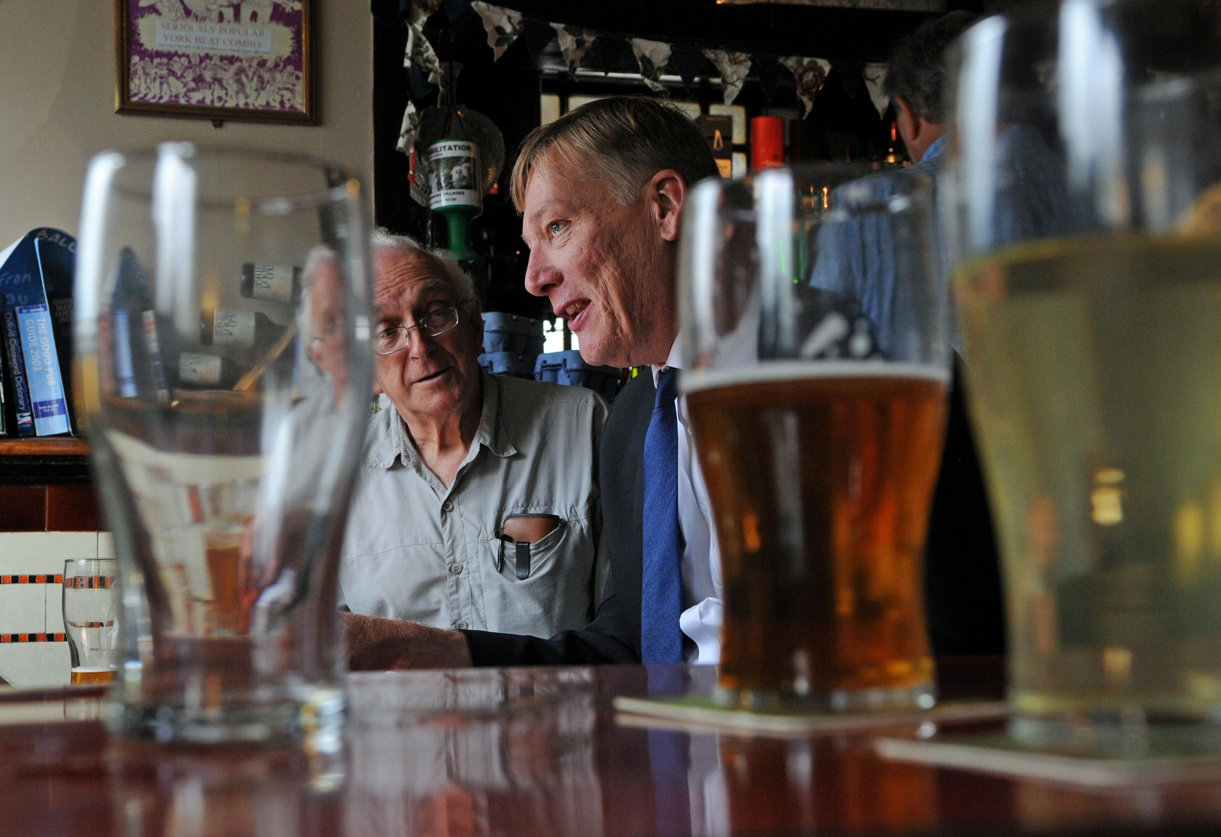 Community pubs minister Kris Hopkins chats with customers during his visit to the Golden Ball in Bishophill, York