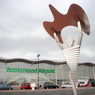 Robin Hood Airport, Doncaster, has been closed after a plane with an undercarriage fault had to land next to the runway