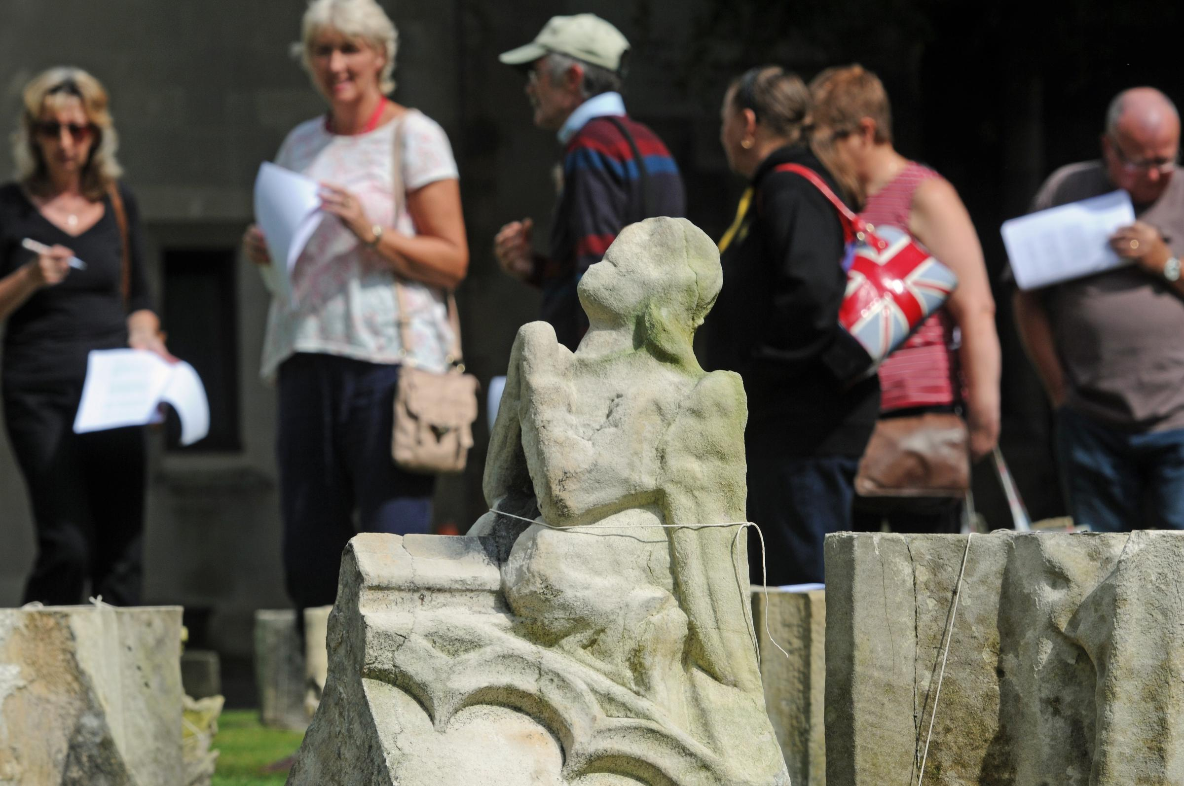 Prospective buyers, in Dean's Park, view items in the York Minster stone auction.