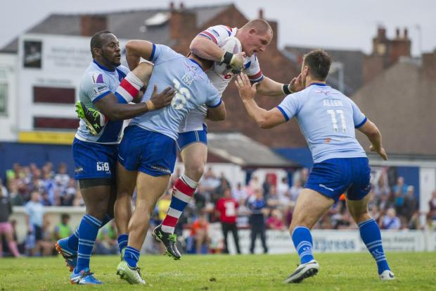 Richard Moore, playing for Wakefield versus Widnes, is the most notable of Hunslet's deadline-week recruits ahead of the Championship One play-offs
